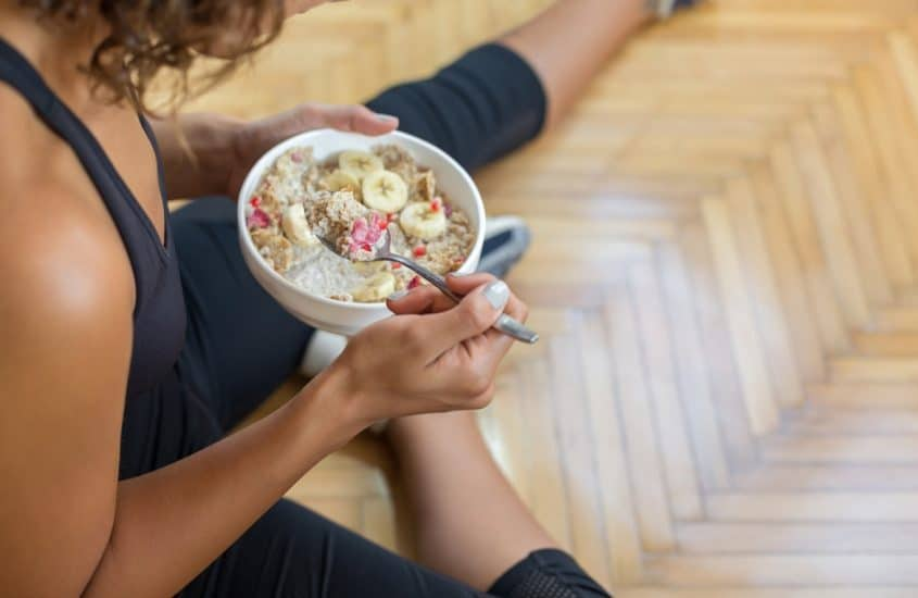 woman sitting down eating a breakfast
