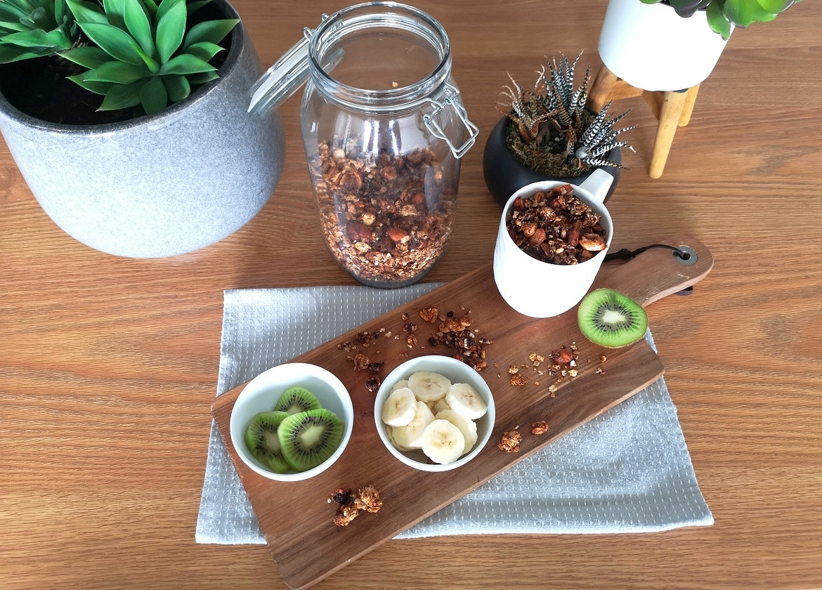 Homemade Granola recipe presentation with fruits and plants for decoration