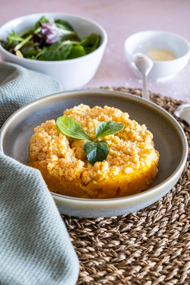 Butternut crumble with parmesan laid on a plate