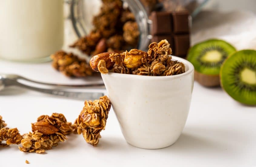 Homemade granola presented in a cup on a white table