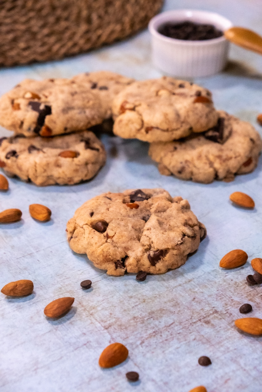 The best vegan cookies, blue background with almonds