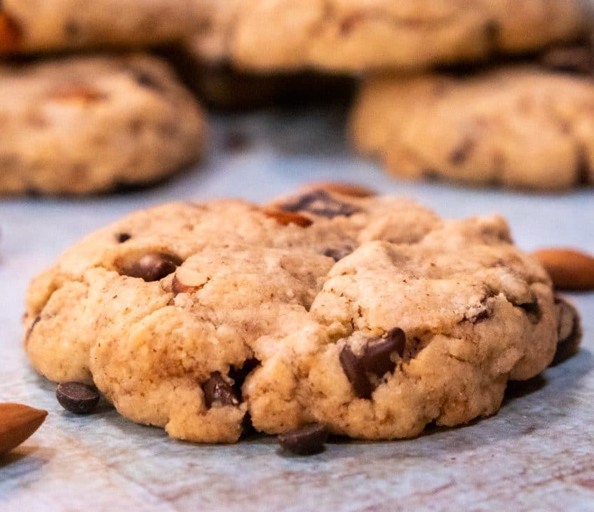 The best vegan cookies, blue background with almonds. Zoom view